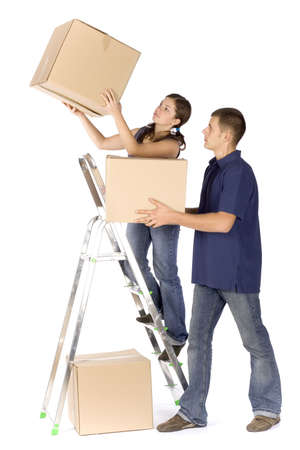 man and woman (workers) at the ladder with boxes photo