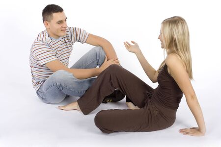 converse: sitting young woman and man having a conversation