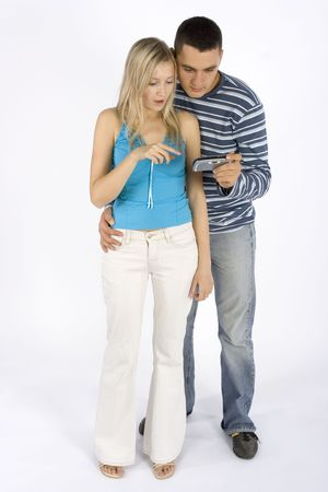 communicaton: young woman and man with mobile phonepalmtop Stock Photo