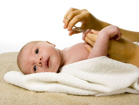 woman cut baby's nails by scissors Stock Photo - 676924