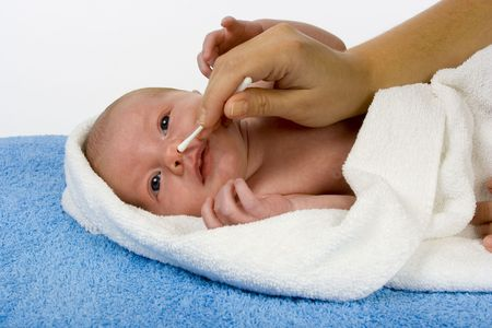 woman hand cleans baby's nose Stock Photo - 676925