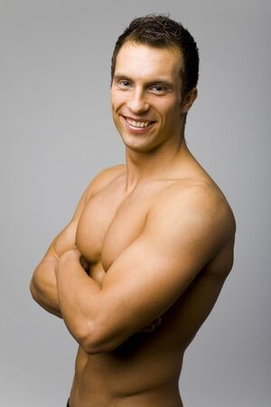Portrait of young and muscular man with nacked tanned body. Stock Photo