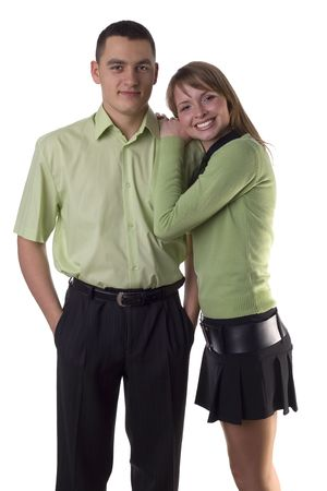 nestle: Young woman nestle her boyfriends shoulder. Isolated on white in studio.