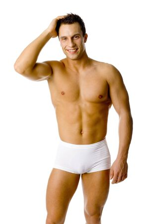 young underwear: Muscular and smiled mans sanding. Isolated on white in studio.