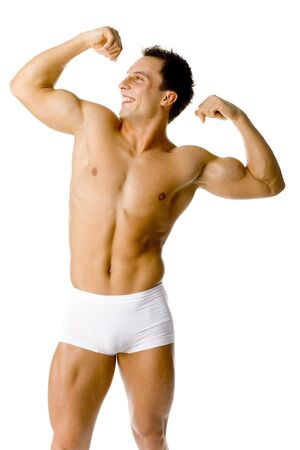 potency: Muscular happy mans standing, flexing his body. Isolated on white in studio.