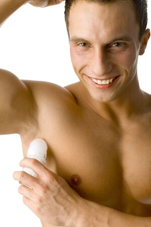 Muscular mans using an antiperspirant. Isolated on white in studio.