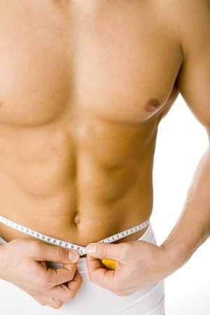 body slim: Musculaire et digne homme  's de mesure de la taille. Isol� sur blanc dans le studio.