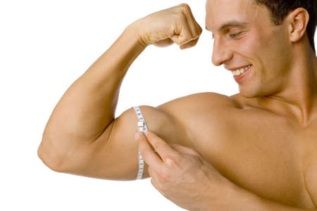 mesure: Happy smiled mans mesuring his biceps. Isolated on white in studio.
