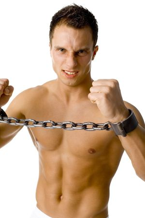 prisoner man: Chained young athletic man. Looks angry. Isolated on white in studio.