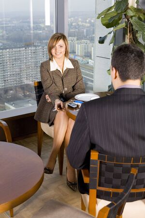 Man and Woman at the Cofe Table next to the Window (Big City View). Stock Photo - 776149