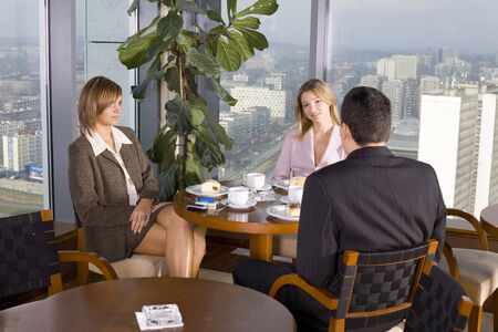 Group of People at the Cofe Table next to the Window (Big City View). Stock Photo - 776148