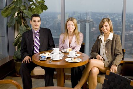 Group of People at the Cofe Table next to the Window (Big City View). Stock Photo - 776147