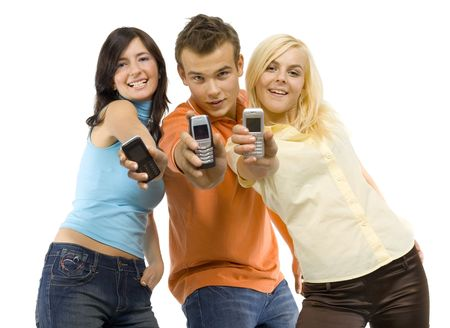 Two young woman and a man between them. Theyre showing mobile phones screen. Isolated on white in studio. Stock Photo