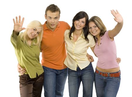 Group of young people. Theyre standing and looking at the camera. Two women are waving to the camera. Isolated on white in studio.