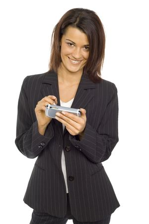pocket pc: Formalwear woman standing and smiling at  camera. Shes holding pocket pc and pen. Isolated on white in studio.