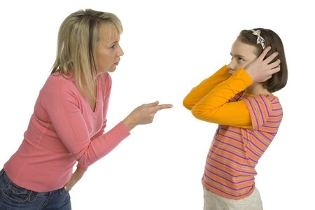 Mother is disciplining her 10-12yo daughter. Girls stopping her ears. Side view. Isolated on white in studio.
