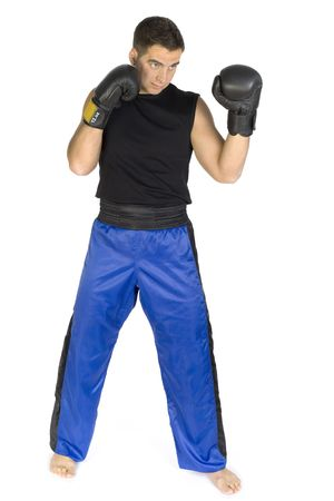 the whole body: Young man in black boxing gloves,, isolated on white in studio. Whole body. Stock Photo