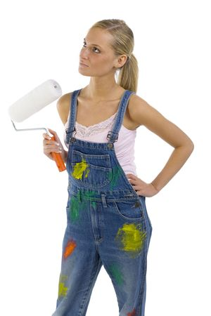 Young blonde wearing dungarees with roll in hand. Isolated on white in studio Stock Photo - 957663