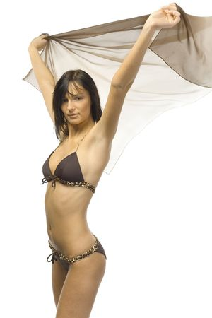 whiff: Young, sexy woman wearing bikini and holding shawl. Hands up. Isolated on white in studio. Looking at camera Stock Photo