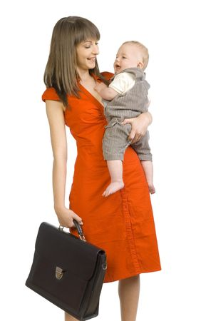Young smiling mother with baby boy on hand. In other holding briefcase. Looking at child. Isolated on white