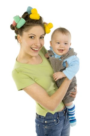 Young, beautiful woman with baby on hands. Smiling and looking at camera photo