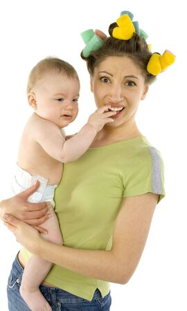 Young, depressed woman with baby on hands. Baby is putting hand in mothers mouth. Woman is looking at camera photo