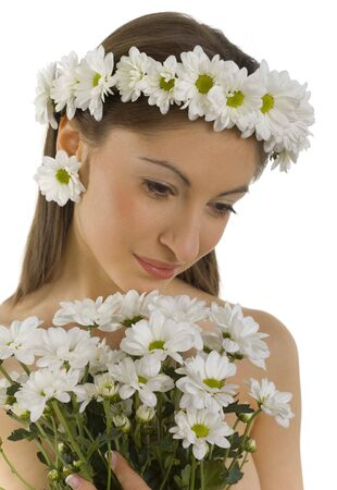 modest: Young, beautiful and  modest woman with bouquet of white flowers. White background