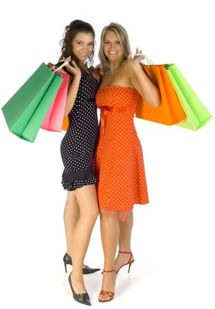18 19: Two beautiful, young woman standing and holding bags. Looking at camera, isolated on white in studio. Whole body