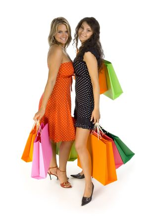 Two beautiful, young woman standing and holding bags. Looking at camera, isolated on white in studio. Whole body Stock Photo - 1290320