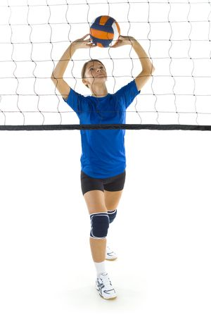 sportingly: Young, beauty volleyball player. Standing in front of net with ball. White background. Whole body, front view