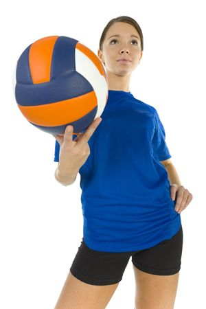 sportingly: Young, beauty volleyball player. Holding ball, smiling and looking at something. White background, high angle view