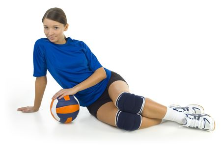 emulate: Young, beauty volleyball player. Lying on the floor and holding ball. Looking at camera. Isolated on white in studio. Whole body, front view