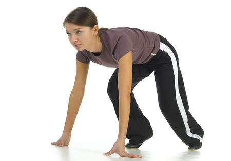 the whole body: Young woman preparing to race. White background. Side view, whole body