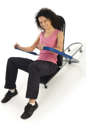 sportingly: Young woman during exercising abdominal muscle. Smiling and looking at camera. White background.