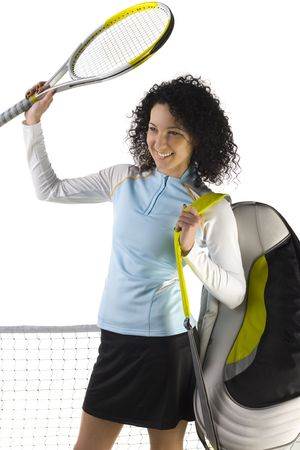 Young woman with backpack and holding up tennis racket. White background, front view. Stock Photo - 2606009