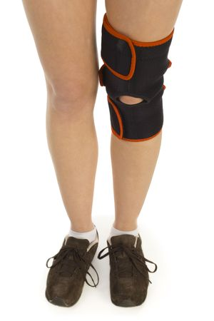 tourniquet: Legs with tourniquet on contusion knee. White background, front view.