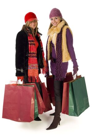 Two young women on shopping. Theyre smiling and looking at camera. Front view, isolated on white background. photo