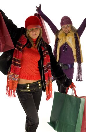 Two happy women with shopping bags. Looking at camera, front view. White background. Stock Photo - 2606038
