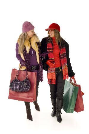 Two happy and talking women on shopping. Front view, isolated on white background. photo