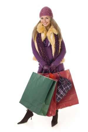 Young woman with shopping bags. Smiling and looking at camera. Isolated on white background, front view. photo