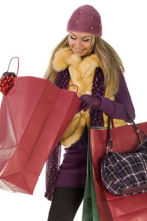 Young, happy woman looking into shopping bag. Front view, white background. photo