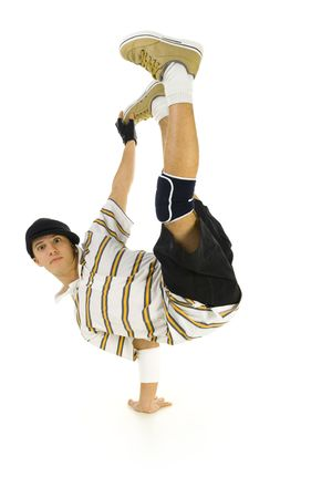 down beat: Young bboy standing on one hand. Holding legs in air. Looking at camera. Isolated on white in studio. Front view, whole body Stock Photo
