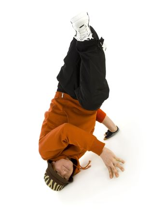 Young bboy holding up on hands and head. Holding legs in air. Looking at camera. Isolated on white in studio. Front view, whole body photo