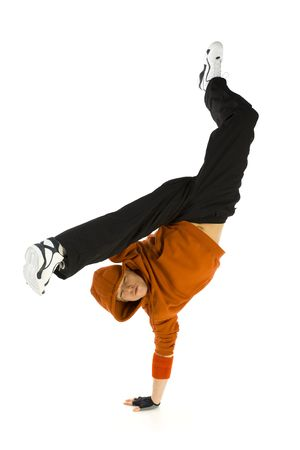 causal: Young hooded bboy standing on one hand. Holding legs in air. Looking at camera. Isolated on white in studio. Front view, whole body