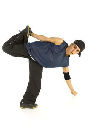 breakin: Young bboy holding up on hand and standing on one leg. Looking at camera. Isolated on white in studio. Front view, whole body Stock Photo