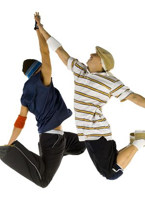 breakin: Two bboys freezed in jump. Smiling and giving high five. Side view, white background