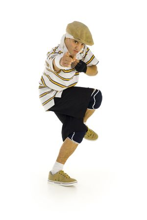 the whole body: Young, angry bboy standing on one leg. Looking and pointing at camera. Isolated on white in studio. Side view, whole body