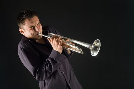 Man in shirt trumpet with might and main. Front view. Stock Photo
