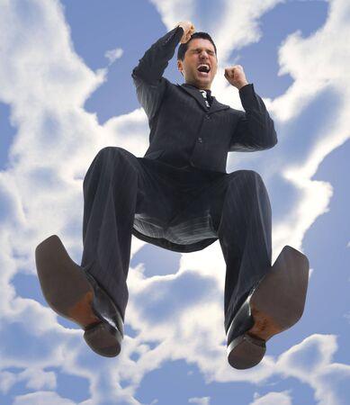 Young, happy and screaming businessman. Low angle view photo