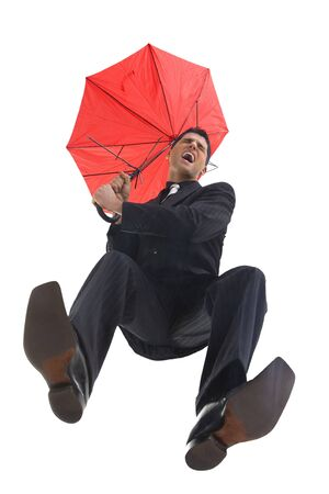 Young, screaming businessman with umbrella. He looks like he is falling. Low angle view photo